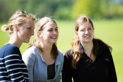 three student girls smiling